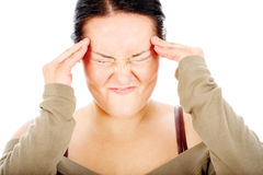 Chubby woman have headache Royalty Free Stock Photography