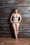 Chubby woman in lingerie posing Stock Photo