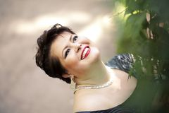 Chubby woman smiling Royalty Free Stock Images