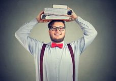 Excited student with books on head stock images