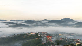 The chuch in fog ,The small village in fog, somewhere near Dalat, Vietnmam. The small village in fog, some where near Dalat, Vietnam- DALAT Stock Photos