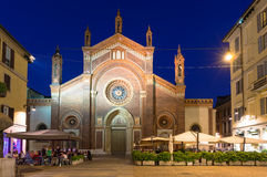 Chuch and square with restaurant at night in Milan Royalty Free Stock Images