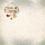 Chuchería de la Navidad en el fondo de la tela texturizada vieja Fotografía de archivo libre de regalías