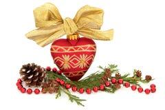 Chuchería y flora de la Navidad Fotos de archivo