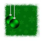 Chucherías de la Navidad en marco congelado con los copos de nieve en verde Imágenes de archivo libres de regalías