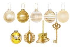 Chucherías de oro del Año Nuevo de la Navidad Fotos de archivo libres de regalías