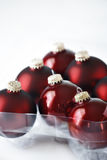 Chucherías rojas de la Navidad Imagen de archivo libre de regalías