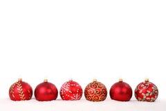 Chucherías rojas de la Navidad en la línea aislada Imágenes de archivo libres de regalías