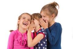 Chuchotement d'enfants photographie stock