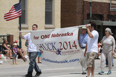 Chuck Hassebrook for Nebraska Governor banner in a parade in small town America Royalty Free Stock Image
