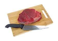 Chuck roast on cutting board with knife Royalty Free Stock Photography