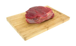 Chuck roast on wood cutting board Royalty Free Stock Image