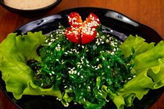 Chucka salad with sesame seeds. And tomato stock images