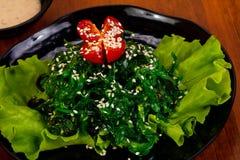 Chucka salad with sesame seeds. And tomato stock photos
