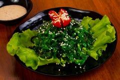 Chucka salad with sesame seeds. And tomato stock photography