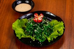 Chucka salad with sesame seeds. And tomato royalty free stock images