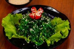 Chucka salad with sesame seeds. And tomato royalty free stock photo