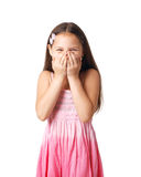 Chuckle. Portrait of a little girl hiding her smile in her hands Stock Photography