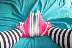 Chucks on bed Royalty Free Stock Photography