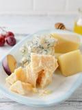 Chucks of cheeses close-up Stock Photos