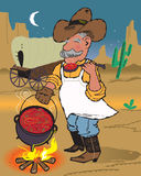 Chuckwagon Chili. A cowboy cook sampling his dinner from the kettle Stock Photos