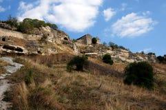 Chufut-Col rizada - una ciudad de la cueva. Fotografía de archivo libre de regalías