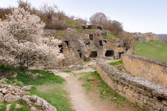 Chufut-Kale in Crimea in spring. Chufut-Kale is a medieval city-fortress in the Crimean Mountains that now lies in ruins Royalty Free Stock Image