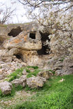 Chufut-Kale in Crimea in spring. Chufut-Kale is a medieval city-fortress in the Crimean Mountains that now lies in ruins Stock Photography