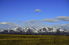 Chugach mountain range. A view of an Alaskan mountain range known as Chugach mountain range with snow on top in the distance stock image