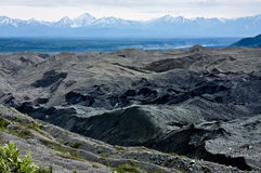 Chugach Mountains and Root Glacier Moraine. View of the Chugach Mountains and the Root Glacier moraine from the Root Glacier Trail in Alaska's Wrangell St. Elias royalty free stock image