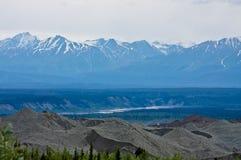 Chugach Mountains and Root Glacier Moraine. View of the Chugach Mountains and the Root Glacier moraine from the Root Glacier Trail in Alaska's Wrangell St. Elias royalty free stock photo