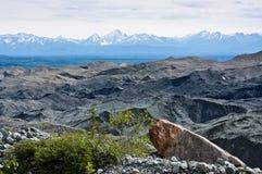 Chugach Mountains and Root Glacier Moraine. View of the Chugach Mountains and the Root Glacier moraine from the Root Glacier Trail in Alaska's Wrangell St. Elias stock photo