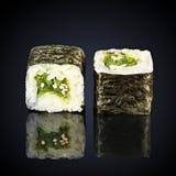 Chuka seaweed rolls. On a black background Royalty Free Stock Photos