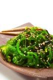 Chuka Seaweed Salad. Japanese Cuisine - Chuka Seaweed Salad. Served with Nuts Sauce and Sesame Royalty Free Stock Images