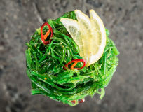 Chuka seaweed salad. With reflection over concrete background Royalty Free Stock Photography