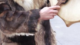 Chukchi musical instrument. Playing the Chukchi musical wind instrument stock video footage