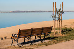 Chula Vista Bayfront Park bench with San Diego Bay. Empty bench at Chula Vista Bayfront park with San Diego bay and Point Loma in the background Royalty Free Stock Photography