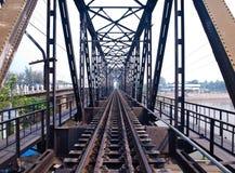 Chulalongkorn Bridge. Cross over Mae Klong River in Ratchaburi, Thailand Royalty Free Stock Photo
