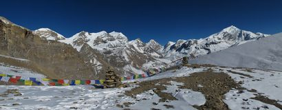 Chulu West, Purbung Himal and prayer flags Royalty Free Stock Images