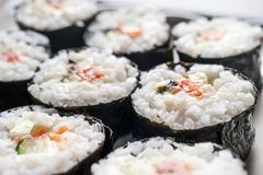 Chumaki Sushi Rolls with Tuna, Salmon, Rice, Cucumber, Avocado And Nori Seaweed on a Plate.  royalty free stock photography