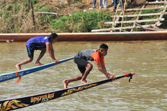 CHUMPHON, THAILAND - OCT 21: Boaters climb on bow to race flag i Stock Image