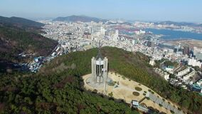 Chunghontap Pagoda in Central Park, Busan, South Korea, Asia. When Mar-14-2018. Chunhontap is Monument for the war dead stock video