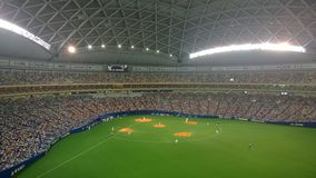 A Chunichi Dragons Baseball Game at Nagoya Dome in Nagoya, Japan. A super high resolution shot of a Chunichi Dragons Baseball game at the enormous Nagoya Dome Stock Photo