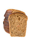 Chunk of bread with raisin against the cut loaf Royalty Free Stock Photos