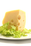 Chunk of cheese and lettuce Stock Photos
