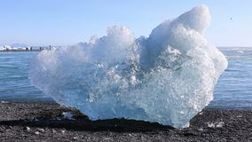 Chunk of ice from the Jokulsarlon glacial lagoon stock footage