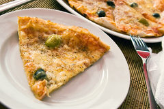 Chunk of pizza. Chunk of delicious italian pizza with olives Royalty Free Stock Image
