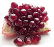 Chunk of pomegranate with seeds Royalty Free Stock Photos
