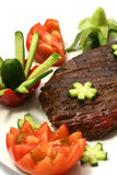 Chunk of roast meat and vegetables Royalty Free Stock Images