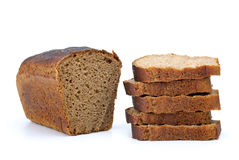Chunk of rye bread with anise and some slices. Isolated on the white background Stock Photo